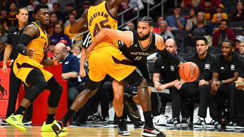 LOS ANGELES, CA - DECEMBER 07: Nevada forward Cody Martin (11) is trapped by Arizona State forward Zylan Cheatham (45) during an college basketball game between the Arizona State Sun Devils and the Nevada Wolf Pack in the Air Force Reserve Basketball Hall of Fame Classic on December 7, 2018 at STAPLES Center in Los Angeles, CA. (Photo by Brian Rothmuller/Icon Sportswire via Getty Images)