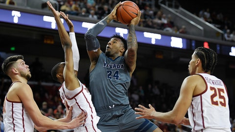 Dec 1, 2018; Los Angeles, CA, USA; Nevada Wolf Pack forward Jordan Caroline (24) attempts a shot while Southern California Trojans guard Shaqquan Aaron (0) defends during the first half at Galen Center. Mandatory Credit: Kelvin Kuo-USA TODAY Sports