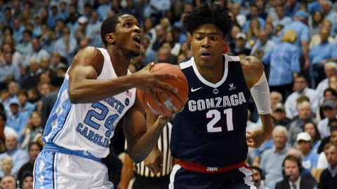 Dec 15, 2018; Chapel Hill, NC, USA; North Carolina Tar Heels guard Kenny Williams (24) drives to the basket past Gonzaga Bulldogs forward Rui Hachimura (21) during the first half at Dean E. Smith Center. Mandatory Credit: Rob Kinnan-USA TODAY Sports