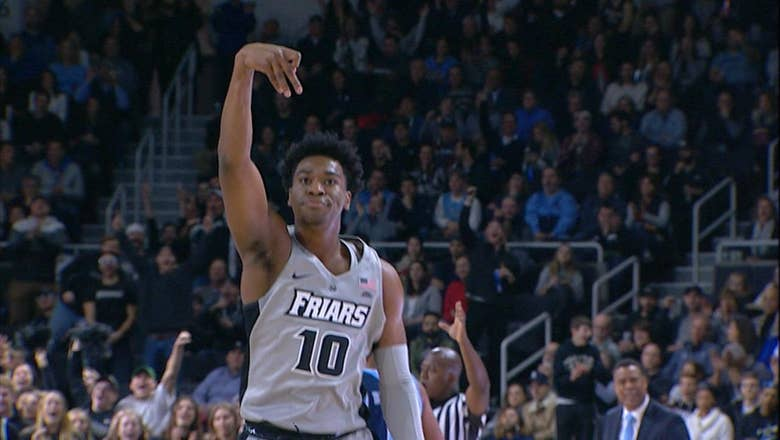 Providence holds on to defeat Rhode Island 59-50