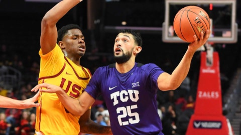 Dec 7, 2018; Los Angeles, CA, USA; USC Trojans guard Elijah Weaver (3) defends TCU Horned Frogs guard Alex Robinson (25) as he drives to the basket in the first half of the game at Staples Center. Mandatory Credit: Jayne Kamin-Oncea-USA TODAY Sports