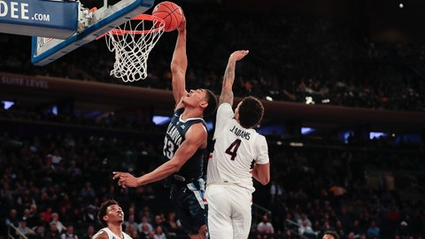 Dec 22, 2018; New York, NY, USA; Villanova Wildcats forward Jermaine Samuels (23) dunks the ball as Connecticut Huskies guard Jalen Adams (4) defends during the second half at Madison Square Garden. Mandatory Credit: Vincent Carchietta-USA TODAY Sports