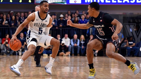 Dec 5, 2018; Villanova, PA, USA; Villanova Wildcats guard Phil Booth (5) dribbles the ball past Temple Owls guard Nate Pierre-Louis (15) during the first half at Finneran Pavilion. Mandatory Credit: Derik Hamilton-USA TODAY Sports