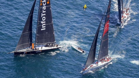 <p>               In this photo provided by Rolex/Studio Borlenghi, maxi yachts Infotrack, left, Wild Oats XI and Scallywag, right, battle for position after the start of the Sydney Hobart yacht race in Sydney, Wednesday, Dec. 26, 2018. (Carlo Borlenghi/Rolex/Studio Borlenghi via AP)             </p>