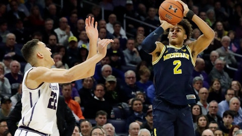 <p>               Michigan guard Jordan Poole, right, shoots against Northwestern forward Pete Nance during the first half of an NCAA college basketball game Tuesday, Dec. 4, 2018, in Evanston, Ill. (AP Photo/Nam Y. Huh)             </p>