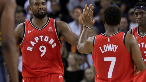 <p>               Toronto Raptors forward Serge Ibaka (9) celebrates with guard Kyle Lowry (7) during the second half of an NBA basketball game against the Golden State Warriors in Oakland, Calif., Wednesday, Dec. 12, 2018. (AP Photo/Jeff Chiu)             </p>