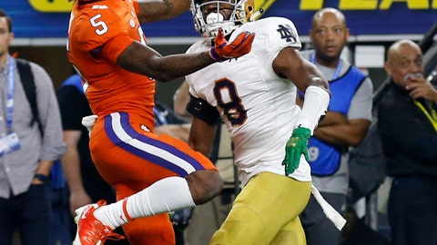 <p>               Clemson wide receiver Tee Higgins (5) reaches up to catch a ball that was tipped by Notre Dame cornerback Donte Vaughn (8) in the end zone for a touchdown late in the first half of the NCAA Cotton Bowl semi-final playoff football game, Saturday, Dec. 29, 2018, in Arlington, Texas. (AP Photo/Roger Steinman)             </p>