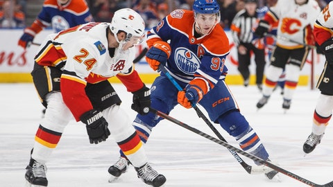 <p>               Calgary Flames' Travis Hamonic (24) tries to stop Edmonton Oilers' Ryan Nugent-Hopkins (93) during second period NHL hockey action in Edmonton, Alberta on Sunday, Dec. 9, 2018. (Jason Franson/The Canadian Press via AP)             </p>