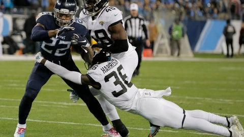 <p>               Tennessee Titans running back Derrick Henry (22) breaks a tackle by Jacksonville Jaguars defensive back Ronnie Harrison (36) during the first half of an NFL football game, Thursday, Dec. 6, 2018, in Nashville, Tenn. Henry scored a touchdown on the play. (AP Photo/James Kenney)             </p>
