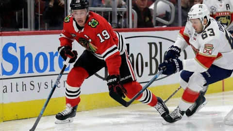 <p>               Chicago Blackhawks center Jonathan Toews, left, controls the puck against Florida Panthers right wing Evgenii Dadonov during the first period of an NHL hockey game Sunday, Dec. 23, 2018, in Chicago. (AP Photo/Nam Y. Huh)             </p>