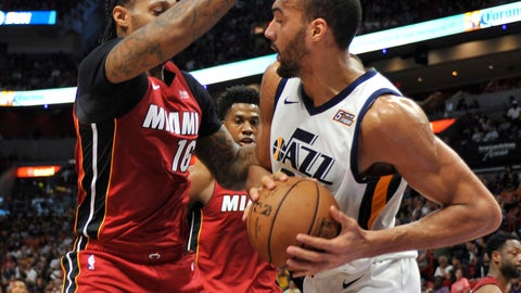 <p>               Utah Jazz center Rudy Gobert (27) dribbles to the basket past the Miami Heat defense of James Johnson (16) during the first half of an NBA basketball game, Sunday, Dec 2, 2018, in Miami. (AP Photo/Gaston De Cardenas)             </p>