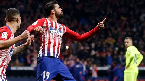<p>               Atletico's Diego Costa, center, celebrates after scoring the opening goal during a Spanish La Liga soccer match between Atletico Madrid and FC Barcelona at the Metropolitano stadium in Madrid, Saturday, Nov. 24, 2018. (AP Photo/Paul White)             </p>