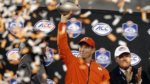 <p>               Clemson head coach Dabo Swinney raises the trophy after Clemson won the Atlantic Coast Conference championship NCAA college football game against Pittsburgh in Charlotte, N.C., Saturday, Dec. 1, 2018. (AP Photo/Chuck Burton)             </p>