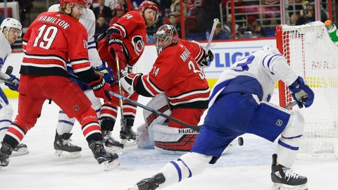 <p>               Toronto Maple Leafs' Tyler Ennis shoots and scores while Carolina Hurricanes goalie Petr Mrazek, of the Czech Republic, defends along with Dougie Hamilton (19) and Jaccob Slavin (74) during the first period of an NHL hockey game in Raleigh, N.C., Tuesday, Dec. 11, 2018. (AP Photo/Gerry Broome)             </p>
