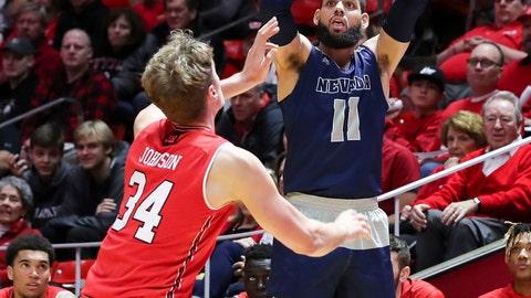 <p>               Nevada forward Cody Martin (11) shoots the ball over Utah center Jayce Johnson (34) during the first half of an NCAA college basketball game, Saturday, Dec. 29, 2018, in Salt Lake City. (AP Photo/Chris Nicoll)             </p>