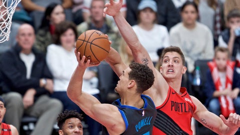 <p>               Dallas Mavericks forward Dwight Powell, left, shoots over Portland Trail Blazers forward Meyers Leonard during the first half of an NBA basketball game in Portland, Ore., Sunday, Dec. 23, 2018. (AP Photo/Craig Mitchelldyer)             </p>