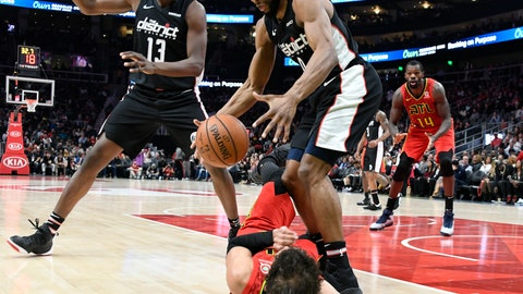 <p>               Washington Wizards guard Chasson Randle steals the ball from Atlanta Hawks guard Trae Young laying on the floor as center Thomas Bryant (13) also defends during the first half of their NBA basketball game Tuesday, Dec. 18, 2018, in Atlanta. (AP Photo/John Amis)             </p>