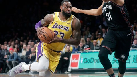 <p>               Los Angeles Lakers' LeBron James (23) drives past Brooklyn Nets' Jarrett Allen (31) during the first half of an NBA basketball game Tuesday, Dec. 18, 2018, in New York. (AP Photo/Frank Franklin II)             </p>