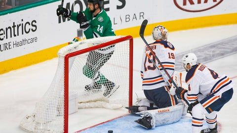 <p>               Dallas Stars left wing Jamie Benn (14) raises his stick after scoring a goal as Edmonton Oilers goaltender Mikko Koskinen (19) and defenseman Kris Russell (4) look on during the third period of an NHL hockey game Monday, Dec. 3, 2018, in Dallas. (AP Photo/Ray Carlin)             </p>