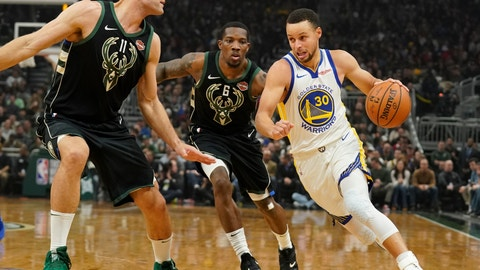 <p>               Golden State Warriors' Stephen Curry drives past Milwaukee Bucks' Eric Bledsoe and Brook Lopez during the first half of an NBA basketball game Friday, Dec. 7, 2018, in Milwaukee. (AP Photo/Morry Gash)             </p>