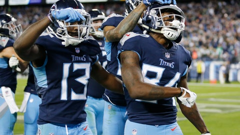 <p>               Tennessee Titans wide receiver Corey Davis (84) celebrates with Taywan Taylor (13) after Davis scored a touchdown on an 11-yard pass against the New York Jets in the fourth quarter of an NFL football game Sunday, Dec. 2, 2018, in Nashville, Tenn. The touchdown gave the Titans a 26-22 win. (AP Photo/James Kenney)             </p>