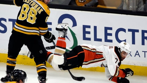 <p>               Boston Bruins right wing David Pastrnak (88) dumps Anaheim Ducks left wing Andrew Cogliano (7) to the ice in the first period of an NHL hockey game, Thursday, Dec. 20, 2018, in Boston. (AP Photo/Elise Amendola)             </p>