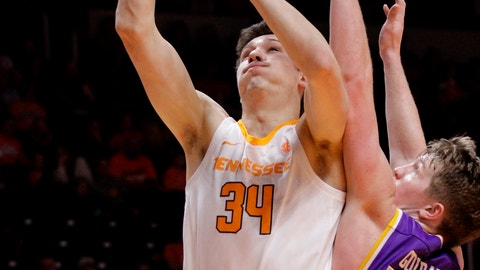 <p>               Tennessee forward Brock Jancek (34) attempts a shot against Tennessee Tech guard Garrett Golday (24) in the second half of an NCAA college basketball game Saturday, Dec. 29, 2018, in Knoxville, Tenn. Tennessee wins 96-53. (AP Photo/Shawn Millsaps)             </p>