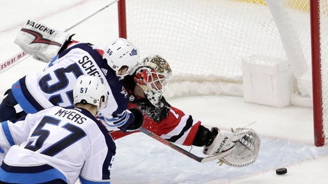 <p>               New Jersey Devils goaltender Keith Kinkaid, right, is unable to stop a shot by Winnipeg Jets center Mark Scheifele (55) during overtime of an NHL hockey game, Saturday, Dec. 1, 2018, in Newark, N.J. (AP Photo/Julio Cortez)             </p>