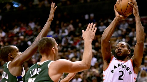<p>               Toronto Raptors forward Kawhi Leonard (2) looks to shoot as Milwaukee Bucks center Brook Lopez (11) and forward Khris Middleton (22) defend during first-half NBA basketball game action in Toronto, Sunday, Dec. 9, 2018. (Frank Gunn/The Canadian Press via AP)             </p>
