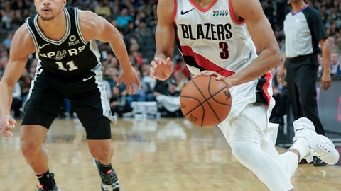 <p>               Portland Trail Blazers' C.J. McCollum (3) drives around San Antonio Spurs' Bryn Forbes during the second half of an NBA basketball game, Sunday, Dec. 2, 2018, in San Antonio. San Antonio won 131-118. (AP Photo/Darren Abate)             </p>