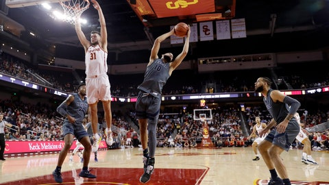 <p>               Nevada forward Caleb Martin (10) grabs a rebound next o Southern California forward Nick Rakocevic (31) during the first half of an NCAA college basketball game Saturday, Dec. 1, 2018, in Los Angeles. (AP Photo/Marcio Jose Sanchez)             </p>