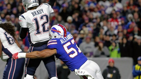 <p>               FILE - In this Oct. 29, 2018, file photo, New England Patriots quarterback Tom Brady (12) is hit from behind by Buffalo Bills linebacker Lorenzo Alexander (57) during an NFL football game in Orchard Park, N.Y. The Bills play at the patriots on Sunday.  The Patriots can lock up a 10th consecutive division title this week with a win or tie against Buffalo. (AP Photo/Chris Cecere, File)             </p>