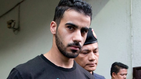 <p>               FILE - In this Tuesday, Dec. 11, 2018, file photo, Thai prison guards lead Bahraini football player Hakeem al-Araibi from court in Bangkok, Thailand. Human rights groups and former soccer players on Saturday, Dec. 22, 2018, in Melbourne, Australia, have called on FIFA and the Australian government to intervene to stop a Melbourne-based refugee and semi-professional soccer player Hakeem from being extradited from Thailand to Bahrain. (AP Photo/Gemunu Amarasinghe, File)             </p>