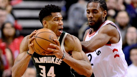 <p>               FILE - In this Dec. 9, 2018, file photo, Toronto Raptors forward Kawhi Leonard (2) puts pressure on Milwaukee Bucks forward Giannis Antetokounmpo (34) as he looks for the pass during second half NBA basketball action in Toronto. With eight shopping days to Christmas, it's time to consider the NBA's decision to spotlight Antetokounmpo and Philadelphia's Joel Embiid in the holiday lineup. The conversation has to include the biggest name to go the opposite direction this past offseason: Leonard, who forced his way out of San Antonio in a trade after missing most of last season with a mysterious leg injury. (Frank Gunn/The Canadian Press via AP, File)             </p>