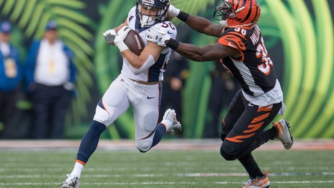 <p>               FILE - In this Sunday, Dec. 2, 2018, file photo, Denver Broncos running back Phillip Lindsay (30) is tackled by Cincinnati Bengals strong safety Shawn Williams (36) during the first half of the NFL football game in Cincinnati. A terrific trio of rookies, including Lindsay, have led a turnaround from a 3-6 start to help Denver win three straight and get into the playoff picture. (AP Photo/Bryan Woolston, File)             </p>