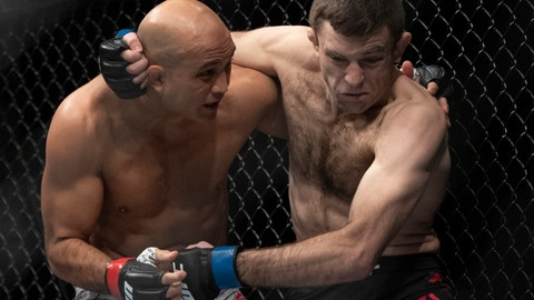<p>               BJ Penn, left, and Ryan Hall fight during the first round of a lightweight mixed martial arts bout at UFC 232, Saturday, Dec. 29, 2018, in Inglewood, Calif. (AP Photo/Kyusung Gong)             </p>