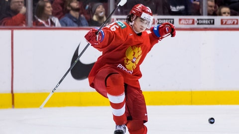 <p>               Russia's Alexander Romanov celebrates his goal against Denmark during second period IIHF world junior hockey championship action in Vancouver, British Columbia on Thursday, Dec. 27, 2018.  (Darryl Dyck/The Canadian Press via AP)             </p>
