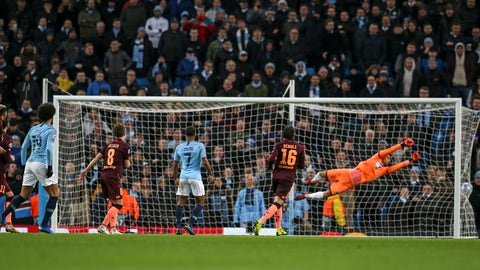 <p>               Manchester City midfielder Leroy Sane, left, scores his side's first goal against Hoffenheim goalkeeper Oliver Baumann, right, during the Champions League Group F soccer match between Manchester City and Hoffenheim at the Etihad stadium in Manchester, England, Wednesday, Dec. 12, 2018. (AP Photo/Dave Thompson)             </p>