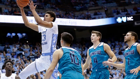 <p>               North Carolina's Cameron Johnson (13) drives to the basket while UNC Wilmington's Kai Toews (10), Shawn O'Connell (4) and Jaylen Fornes (1) defend during the first half of an NCAA college basketball game in Chapel Hill, N.C., Wednesday, Dec. 5, 2018. (AP Photo/Gerry Broome)             </p>