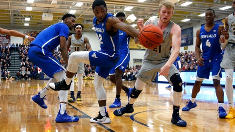 <p>               Buffalo guard Dontay Caruthers (22) looses the ball to Canisius forward Scott Hitchon (21) during the first half of an NCAA college basketball game, Saturday, Dec. 29, 2018, in Buffalo N.Y. (AP Photo/Jeffrey T. Barnes)             </p>