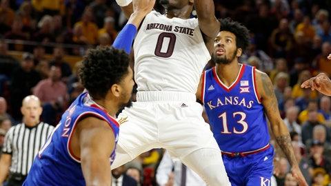 <p>               Arizona State guard Luguentz Dort (0) drives on Kansas guard Devon Dotson (11) during the second half of an NCAA college basketball game Saturday, Dec. 22, 2018, in Tempe, Ariz. Arizona State won 80-76. (AP Photo/Rick Scuteri)             </p>
