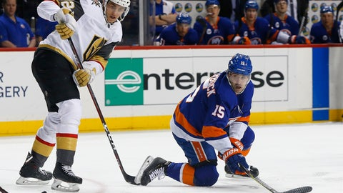 <p>               New York Islanders right wing Cal Clutterbuck (15) plays the puck against Vegas Golden Knights left wing Tomas Nosek during the second period of an NHL hockey game, Wednesday, Dec.12, 2018, in New York. (AP Photo/Noah K. Murray)             </p>