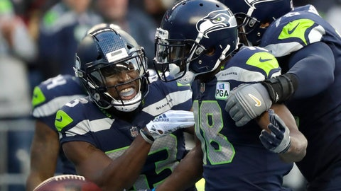 <p>               Seattle Seahawks wide receiver Jaron Brown, center, celebrates with wide receiver David Moore, left, and offensive tackle Duane Brown, right, after catching a pass for a touchdown during the second half of an NFL football game against the San Francisco 49ers, Sunday, Dec. 2, 2018, in Seattle. (AP Photo/Elaine Thompson)             </p>