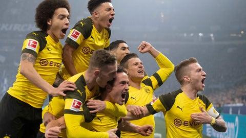 <p>               In this Dec. 8, 2018 photo Dortmund players celebrate after scoring during the Bundesliga soccer match between FC Schalke 04 and Borussia Dortmund in Gelsenkirchen, Germany. Saturday's 2-1 win at Schalke was Dortmund's first Ruhr derby win in three years. (Bernd Thissen/dpa via AP)             </p>