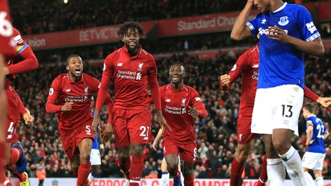 <p>               Liverpool forward Divock Origi, second from left, celebrates after scoring his side's first goal during the English Premier League soccer match between Liverpool and Everton at Anfield Stadium in Liverpool, England, Sunday, Dec. 2, 2018. (AP Photo/Jon Super)             </p>