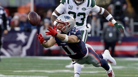 <p>               New England Patriots wide receiver Julian Edelman (11) stretches but cannot catch a pass in front of New York Jets safety Jamal Adams, rear, during the second half of an NFL football game, Sunday, Dec. 30, 2018, in Foxborough, Mass. (AP Photo/Steven Senne)             </p>