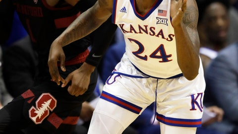 <p>               Kansas guard Lagerald Vick (24) steals the ball from Stanford guard Daejon Davis (1) during the first half of an NCAA college basketball game in Lawrence, Kan., Saturday, Dec. 1, 2018. (AP Photo/Orlin Wagner)             </p>