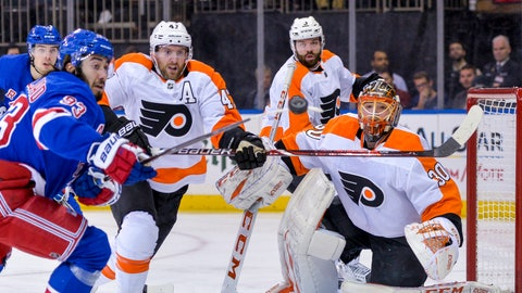 <p>               Philadelphia Flyers goaltender Michal Neuvirth (30) keeps his eyes on a flying puck during the second period of an NHL hockey game against the New York Rangers, Sunday, Dec. 23, 2018, in New York. (AP Photo/Howard Simmons)             </p>