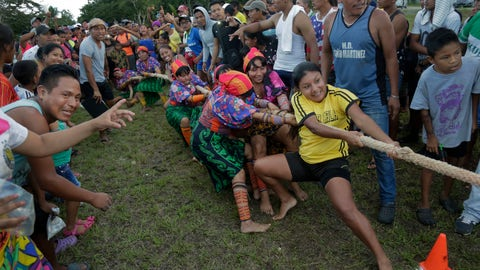 <p>               In this Nov. 25, 2018 photo, Guna indigenous women compete in the tug-of-war during the second edition of the Panamanian indigenous games in Piriati, Panama. Indigenous people from the four most important ethnic groups in Panama participated for two days to select the athletes that will represent Panama in the upcoming World Indigenous Peoples Games. (AP Photo/Arnulfo Franco)             </p>