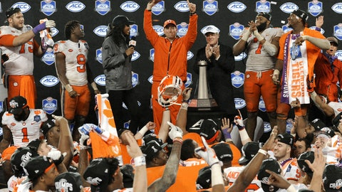 <p>               Clemson head coach Dabo Swinney raises the trophy after Clemson won the Atlantic Coast Conference championship NCAA college football game against Pittsburgh in Charlotte, N.C., Saturday, Dec. 1, 2018. (AP Photo/Mike McCarn)             </p>